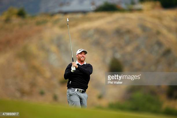 Adam Bland of Australia plays an approach shot on the 18th hole during round three of the New Zealand Open at The Hills Golf Club on March 1 2014 in...
