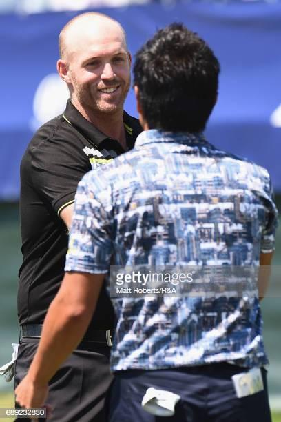 Adam Bland of Australia shakes hands with Katsumasa Miyamoto of Japan on the 18th green during the final round of Mizuno Open at JFE Setonaikai Golf...