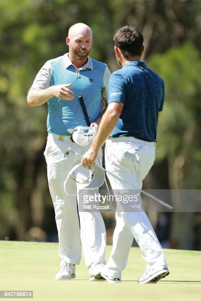 Adam Bland of Australia shakes hands with Louis Oosthuizen of South Africa after winning the shootout decider during round four of the ISPS HANDA...