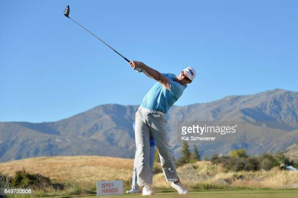 Adam Bland of Australia tees off during day one of the New Zealand Open at The Hills on March 9 2017 in Queenstown New Zealand