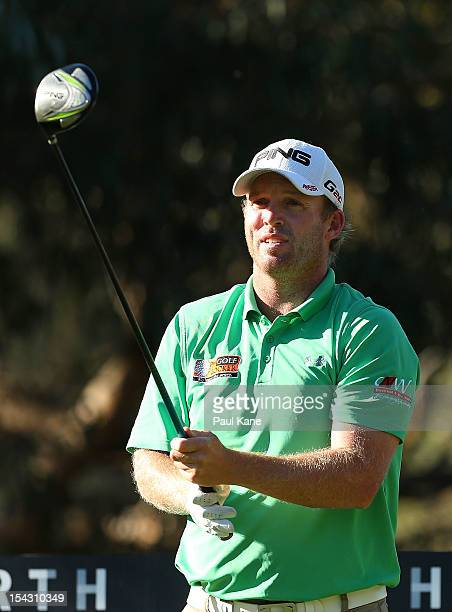 Adam Bland of Australia watches his tee shot on the 11th hole during round one of the Perth International at Lake Karrinyup Country Club on October...