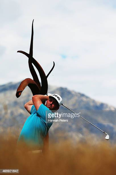 Adam Bland of South Africa tees off during day one of the New Zealand Open at The Hills Golf Club on March 12 2015 in Queenstown New Zealand