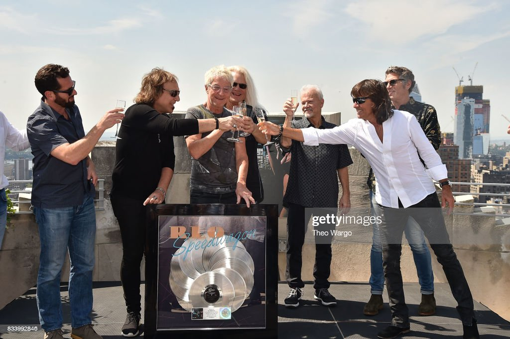 Adam Block, Dave Amato, Kevin Cronin, Bruce Hall, Neal Doughty, Bryan Hitt and Mark Goodman attend REO Speedwagon Receives RIAA Diamond Award For 'Hi Infidelity' at Sony Music on August 17, 2017 in New York City.