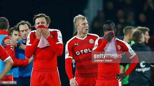 Adam Bodzek and Didier Ya Konan of Duesseldorf react during the Second Bundesliga match between FC St Pauli and Fortuna Duesseldorf at Millerntor...