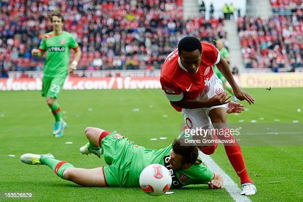 Adam Bodzek of Duesseldorf is challenged by Junior Diaz of Mainz during the Bundesliga match between 1 FSV Mainz 05 and Fortuna Duesseldorf at Coface...