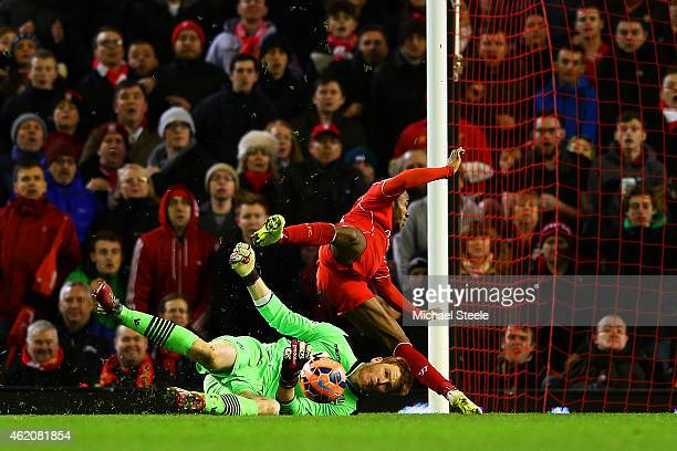 Adam Bogdan of Bolton Wanderers collides with Raheem Sterling of Liverpool as he makes a block during the FA Cup Fourth Round match between Liverpool...