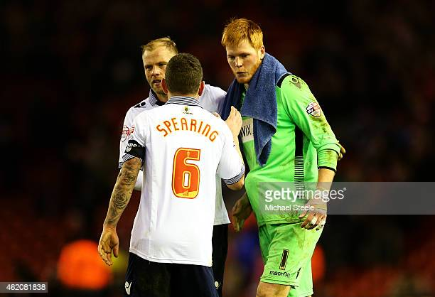 Adam Bogdan of Bolton Wanderers is congratulated by teammates Jay Spearing and Eidur Gudjohnsen after the FA Cup Fourth Round match between Liverpool...