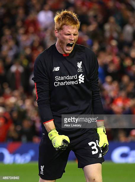 Adam Bogdan of Liverpool celebrates after saving a penalty from Danny Grainger of Carlisle United during a penalty shoot out in the Capital One Cup...