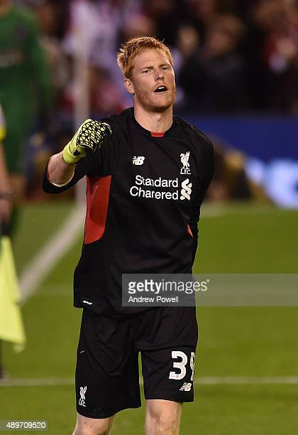 Adam Bogdan of Liverpool celebrates the win during the Capital One Cup third round match between Liverpool and Carlisle United at Anfield on...