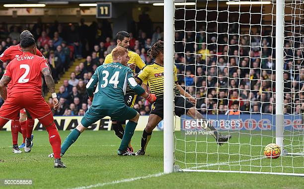 Adam Bogdan of Liverpool drops the ball and Nathan Ak of Watford scores the opening goal during the Barclays Premier League match between Watford and...
