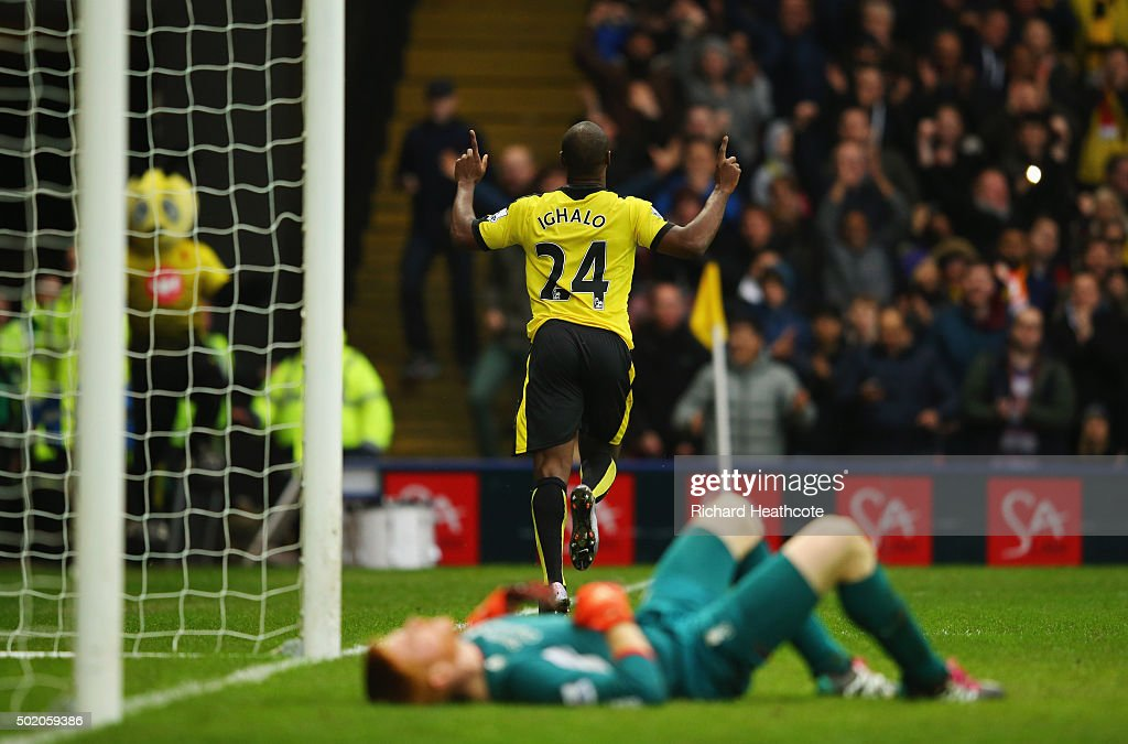 Adam Bogdan of Liverpool (front) looks dejected as Odion Ighalo of Watford celebrates as he scores their third goal during the Barclays Premier League match between Watford and Liverpool at Vicarage Road on December 20, 2015 in Watford, England.