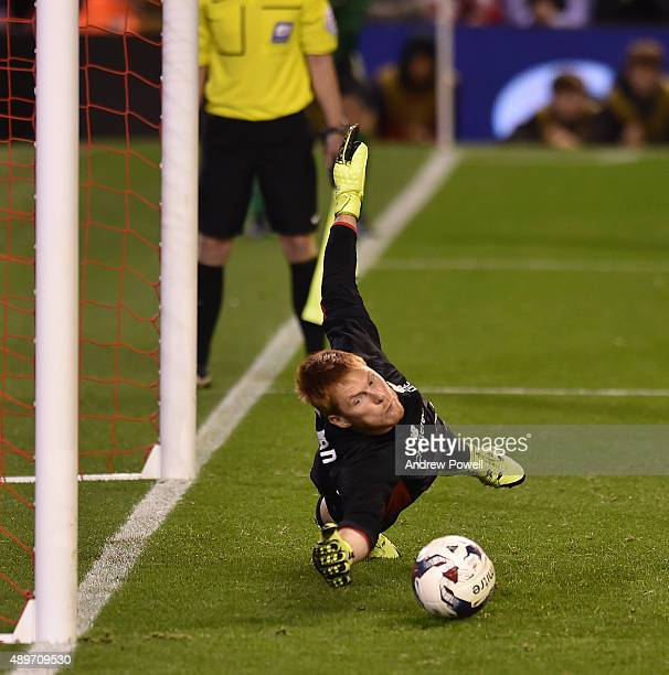 Adam Bogdan of Liverpool saves a penalty from Bastien Henry of Carlisle United to win the game during the Capital One Cup third round match between...