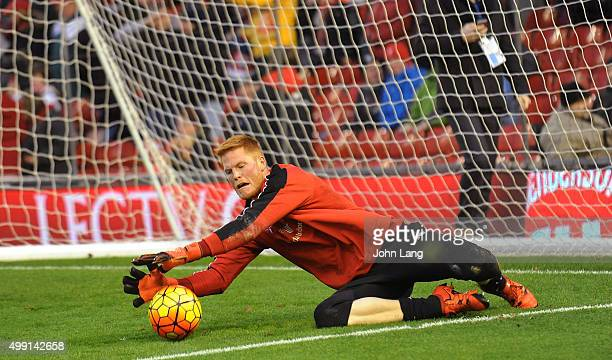 Adam Bogdan of Liverpool warms up before the Barclays Premier League match between Liverpool and Swansea City at Anfield on November 29 2015 in...