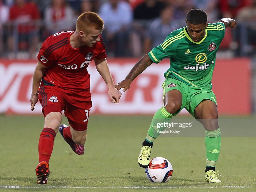 Adam Bouchard #37 of Toronto FC and Liam Briscutt #4 of Sunderland AFC battle for the ball during a friendly match at BMO Field on July 22, 2015 in Toronto, Ontario, Canada.
