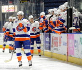 Adam Brace of the Bridgeport Sound Tigers points towards his goaltender after scoring in the second period of an American Hockey League game against...