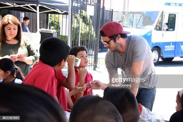 Adam Brody volunteers at Feeding America's Summer Hunger Awareness event At Para Los Ninos in Los Angeles on June 27 2017 in Los Angeles California