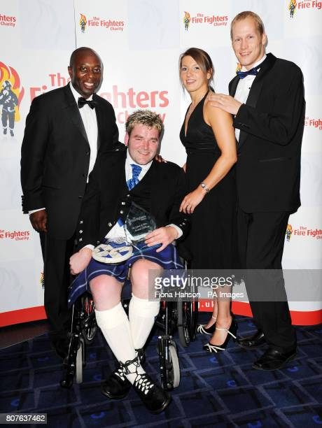 Adam Bruce from Maud Aberdeenshire the winner of the Beneficiary of Courage Award with award presenters former Charlton Athletic footballer Mickey...