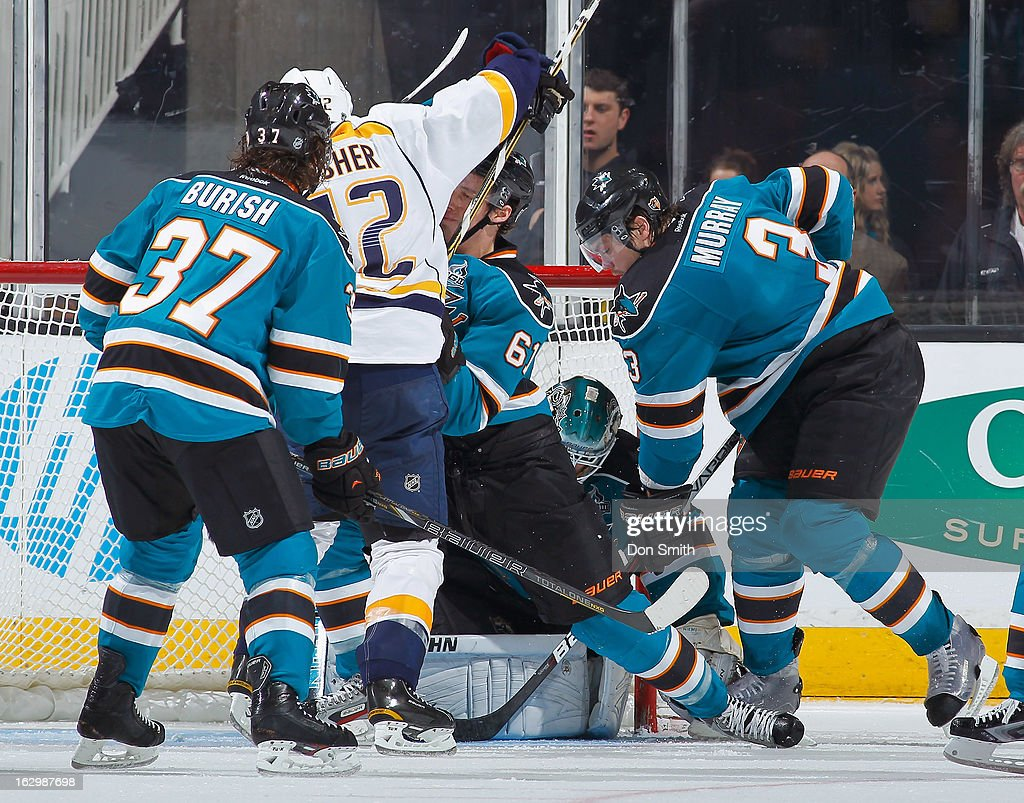 <a gi-track='captionPersonalityLinkClicked' href=/galleries/search?phrase=Adam+Burish&family=editorial&specificpeople=696936 ng-click='$event.stopPropagation()'>Adam Burish</a> #37, Douglas Murray #3, Justin Braun #61 and <a gi-track='captionPersonalityLinkClicked' href=/galleries/search?phrase=Antti+Niemi&family=editorial&specificpeople=213913 ng-click='$event.stopPropagation()'>Antti Niemi</a> #31 of the San Jose Sharks protect the net against <a gi-track='captionPersonalityLinkClicked' href=/galleries/search?phrase=Mike+Fisher+-+Ice+Hockey+Player&family=editorial&specificpeople=204732 ng-click='$event.stopPropagation()'>Mike Fisher</a> #12 of the Nashville Predators during an NHL game on March 2, 2013 at HP Pavilion in San Jose, California.