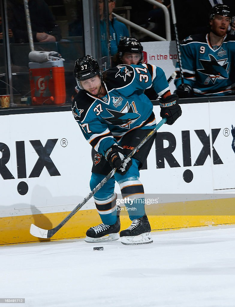 <a gi-track='captionPersonalityLinkClicked' href=/galleries/search?phrase=Adam+Burish&family=editorial&specificpeople=696936 ng-click='$event.stopPropagation()'>Adam Burish</a> #37 of the San Jose Sharks handles the puck against the Nashville Predators during an NHL game on March 2, 2013 at HP Pavilion in San Jose, California.