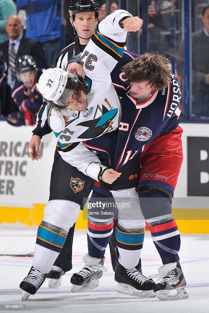 <a gi-track='captionPersonalityLinkClicked' href=/galleries/search?phrase=Adam+Burish&family=editorial&specificpeople=696936 ng-click='$event.stopPropagation()'>Adam Burish</a> #37 of the San Jose Sharks is hit by <a gi-track='captionPersonalityLinkClicked' href=/galleries/search?phrase=Derek+Dorsett&family=editorial&specificpeople=4306277 ng-click='$event.stopPropagation()'>Derek Dorsett</a> #15 of the Columbus Blue Jackets while fighting during the first period on February 11, 2013 at Nationwide Arena in Columbus, Ohio.