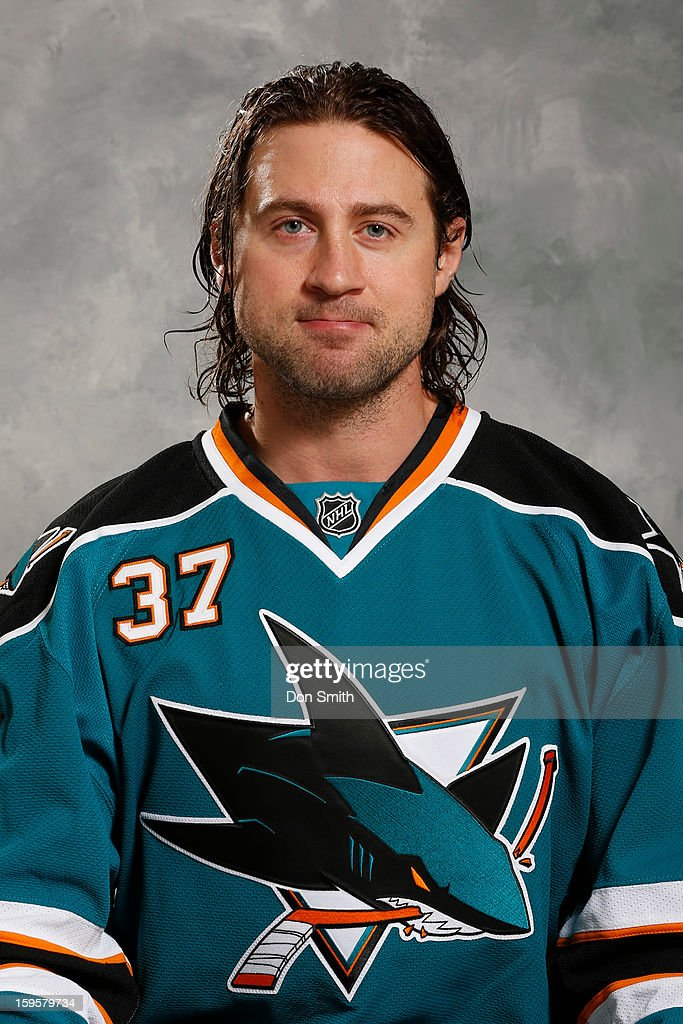 Adam Burish #37 of the San Jose Sharks poses for his official headshot for the 2012-13 season on January 13, 2013 at Sharks Ice in San Jose, California.