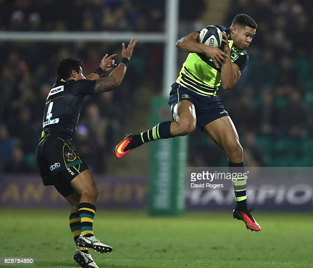 Adam Byrne of Leinster catches the ball as Ken Pisi challenges during the European Rugby Champions Cup match between Northampton Saints and Leinster...