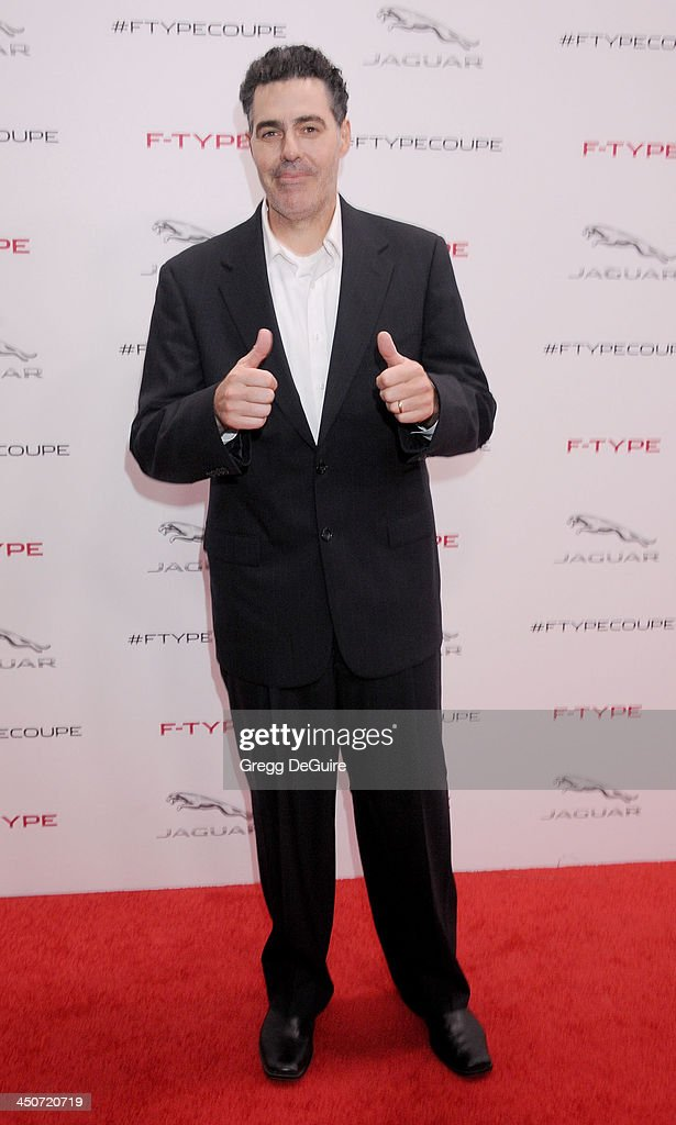Adam Carolla arrives at the Jaguar F-TYPE Coupe launch party at Raleigh Studios on November 19, 2013 in Playa Vista, California.