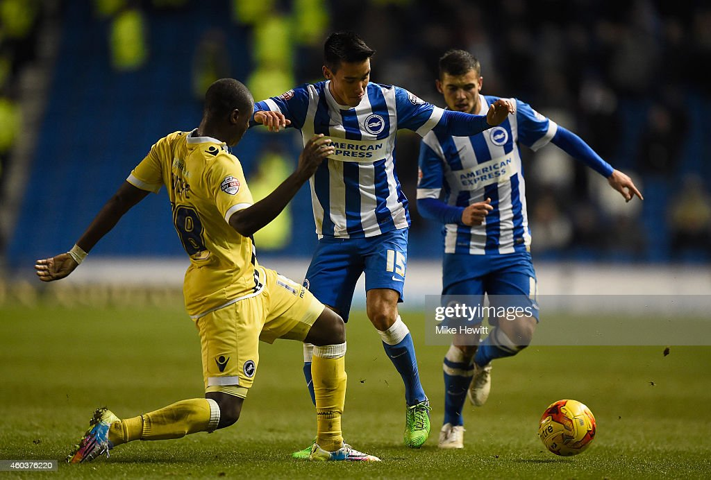 Adam Chicksen of Brighton is challenged by <a gi-track='captionPersonalityLinkClicked' href=/galleries/search?phrase=Magaye+Gueye&family=editorial&specificpeople=7018117 ng-click='$event.stopPropagation()'>Magaye Gueye</a> of Millwall during the Sky Bet Championship match between Brighton & Hove Albion and Millwall at Amex Stadium on December 12, 2014 in Brighton, England.