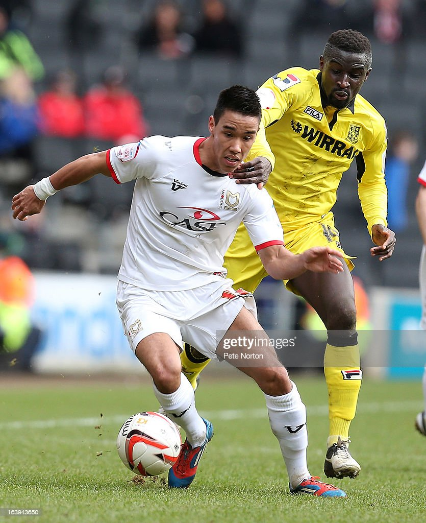 Adam Chicksen of MK Dons attempts to move away from the challenge of Zoumana Bakayogo of Tranmere Rovers during the npower League One match between MK Dons and Tranmere Rovers at Stadium MK on March 16, 2013 in Milton Keynes, England.