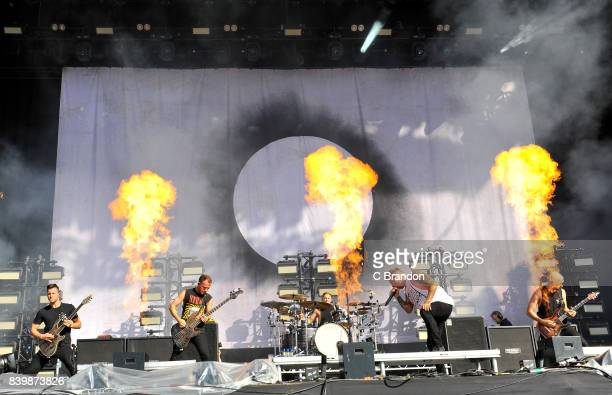 Adam Christianson Alex Dean Dan Searle and Sam Carter of Architects perform on stage during Day 3 of the Reading Festival at Richfield Avenue on...