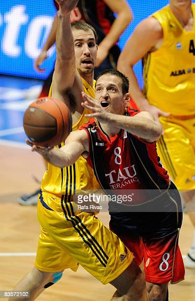 Adam Chubb #14 of Alba Berlin and Igor Rakocevic #8 of TAU Ceramica in action during the Euroleague Basketball Game 3 match between Tau Ceramica and...
