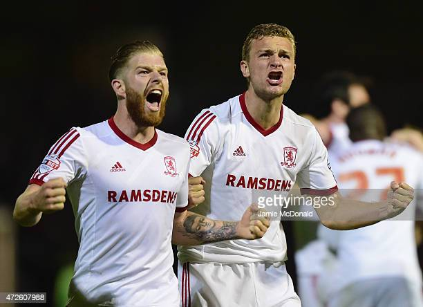Adam Clayton and Ben Gibson of Middlesbrough celebrate during the Sky Bet Championship Playoff semifinal first leg match between Brentford and...