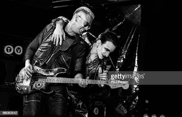 Adam Clayton and Bono of U2 perform on stage on the Zooropa Tour at Kuip on May 10th 1993 in Rotterdam Netherlands Adam Clayton plays a Fender...