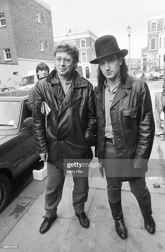 Adam Clayton and Bono of U2 pictured outside SARM Studios in Notting Hill London during the recording of the Band Aid single 'Do They Know It's...