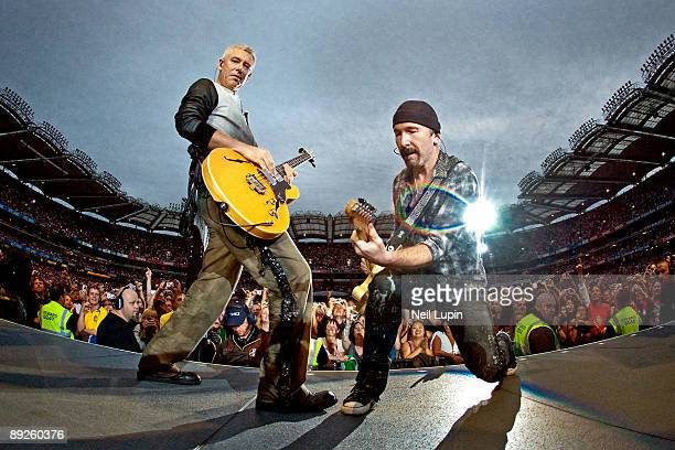 Adam Clayton and The Edge perform on stage for the second night of U2's 360 Degrees World Tour in their home town at Croke Park on July 25 2009 in...