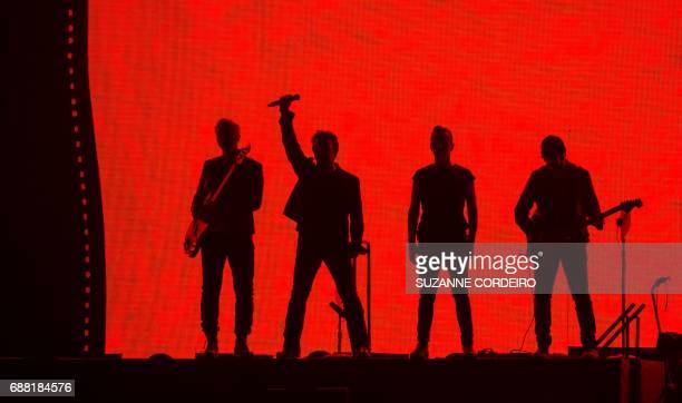 Adam Clayton Bono Larry Mullen Jr and The Edge of U2 perform onstage on The Joshua Tree Tour at NRG Stadium on May 24 2017 in Houston Texas / AFP...
