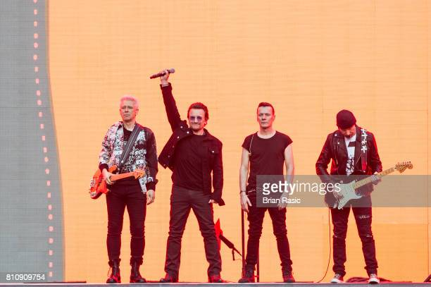 Adam Clayton Bono Larry Mullen Jr and The Edge of U2 performing at Twickenham Stadium on July 8 2017 in London England