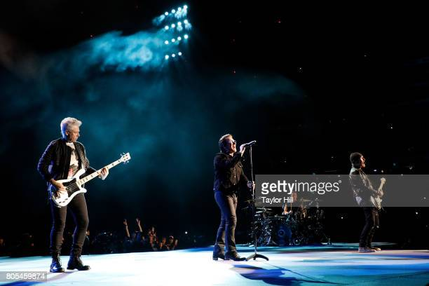 Adam Clayton Bono Larry Mullen Jr and The Edge of U2 performs during 'The Joshua Tree Tour 2017' at MetLife Stadium on June 29 2017 in East...