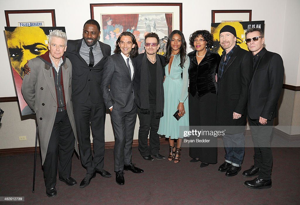 Adam Clayton, <a gi-track='captionPersonalityLinkClicked' href=/galleries/search?phrase=Idris+Elba&family=editorial&specificpeople=215443 ng-click='$event.stopPropagation()'>Idris Elba</a>, <a gi-track='captionPersonalityLinkClicked' href=/galleries/search?phrase=Justin+Chadwick&family=editorial&specificpeople=4584510 ng-click='$event.stopPropagation()'>Justin Chadwick</a>, <a gi-track='captionPersonalityLinkClicked' href=/galleries/search?phrase=Bono+-+Singer&family=editorial&specificpeople=167279 ng-click='$event.stopPropagation()'>Bono</a>, <a gi-track='captionPersonalityLinkClicked' href=/galleries/search?phrase=Naomie+Harris&family=editorial&specificpeople=238918 ng-click='$event.stopPropagation()'>Naomie Harris</a>, Zenani Mandela, The Edge, and Larry Mullen, Jr. attend U2 And Anna Wintour Host A Special Screening Of Mandela: Long Walk To Freedom, In Partnership With Burberry And The New York Times at Ziegfeld Theatre on November 25, 2013 in New York City.
