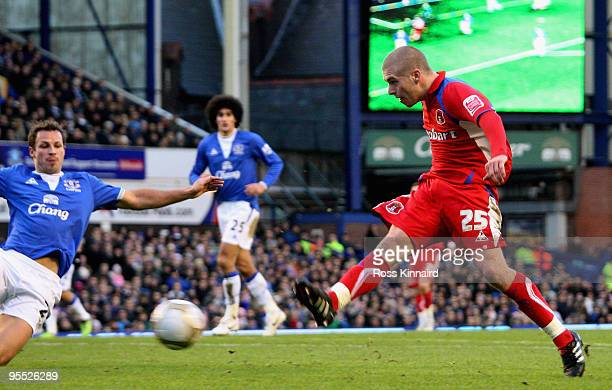 Adam Clayton of Carlisle shoots to score his team's first goal deflected in by teammate Kevan Hurst during the third round match of The FA Cup...