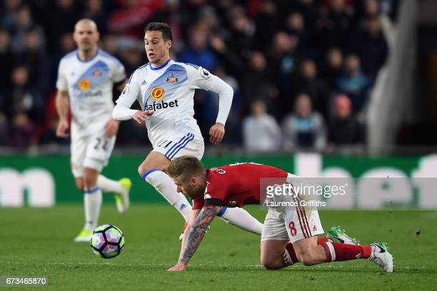 Adam Clayton of Middlesbrough and Javier Manquillo of Sunderland in action during the Premier League match between Middlesbrough and Sunderland at...