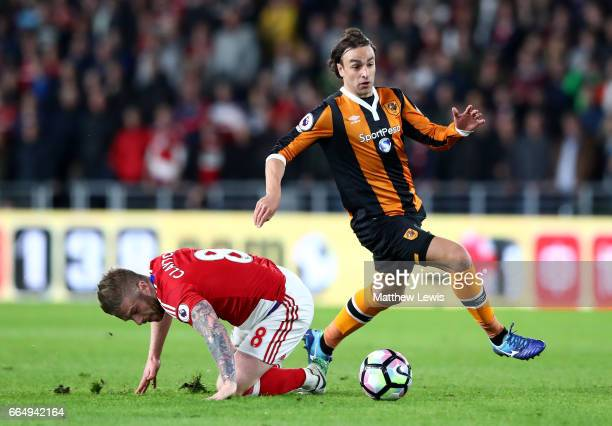 Adam Clayton of Middlesbrough and Lazar Markovic of Hull City battle for possession during the Premier League match between Hull City and...