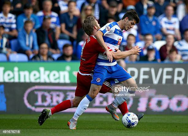 Adam Clayton of Middlesbrough and Lucas Piazon of Reading battle for the ball during the Sky Bet Championship match between Reading and Middlesbrough...