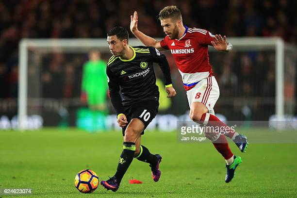 Adam Clayton of Middlesbrough chases down Eden Hazard of Chelsea uring the Premier League match between Middlesbrough and Chelsea at Riverside...
