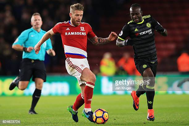Adam Clayton of Middlesbrough is closed down by Victor Moses of Chelsea during the Premier League match between Middlesbrough and Chelsea at...
