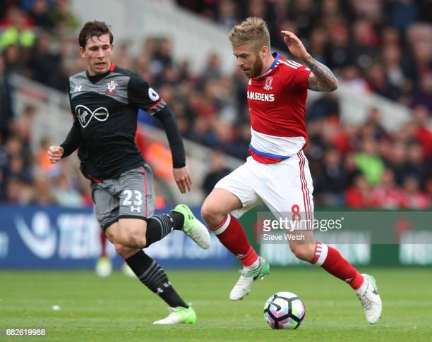 Adam Clayton of Middlesbrough is put under pressure from PierreEmile Hojbjerg of Southampton during the Premier League match between Middlesbrough...
