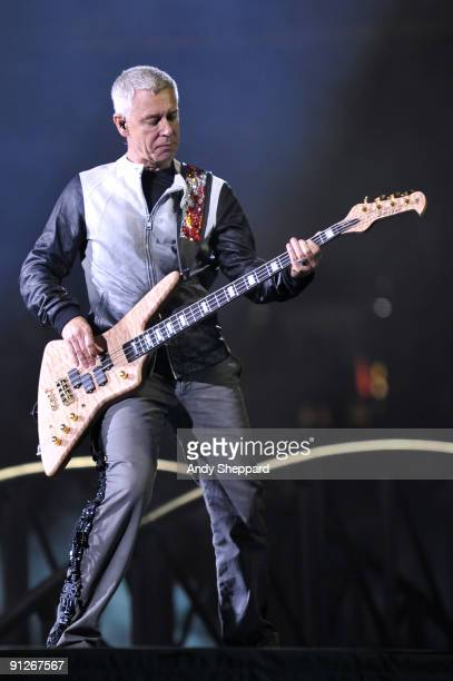 Adam Clayton of U2 performs on stage at FedExField on September 29 2009 in Landover Maryland
