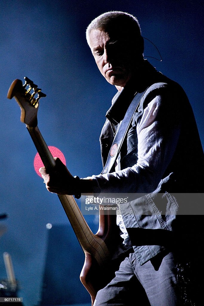 Adam Clayton performs during the U2 360 tour at Soldier Field on September 13 2009 in Chicago Illinois