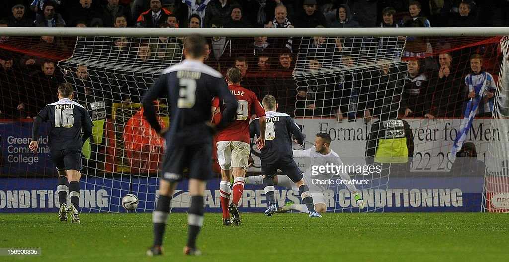 Adam Clayton scores a penalty for Hudderfield during the npower Championship match between Charlton Athletic and Huddersfield Town at The Valley on November 24, 2012 in London, England.