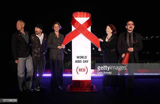 Adam Clayton The Edge New South Wales Premier Kristina Keneally Prime Minister Julia Gillard and U2 front man Bono pose after flicking the switch to...